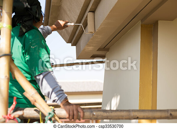 Painter on wooden scaffold painting  Exterior House  - csp33530700