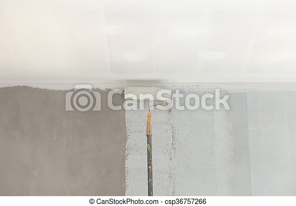 painting a wall and ceiling with roller - csp36757266