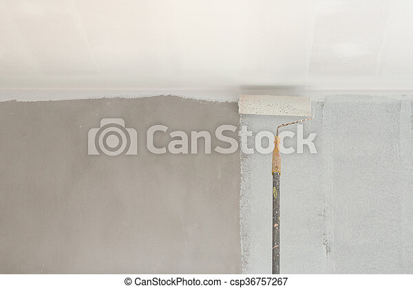 painting a wall and ceiling with roller - csp36757267