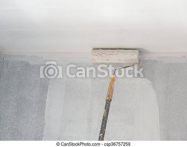 painting a wall and ceiling with roller - csp36757259