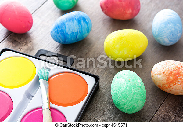 Painting Colorful Easter eggs on wooden background - csp44515571
