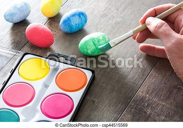 Painting Colorful Easter eggs on wooden background - csp44515569