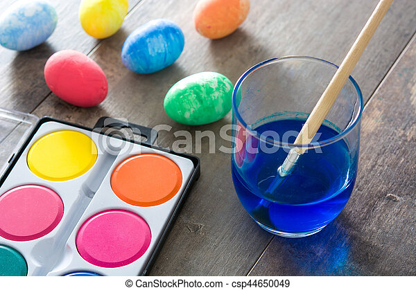 Painting Colorful Easter eggs on wooden background - csp44650049