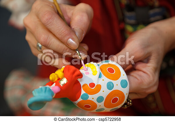 Painting pottery figurines. Russian folk craft. Close-up photos. - csp5722958
