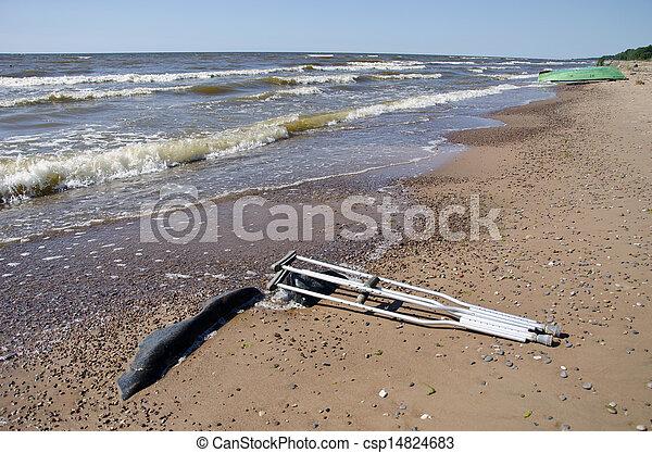 pair crutches on beach sand near sea - csp14824683