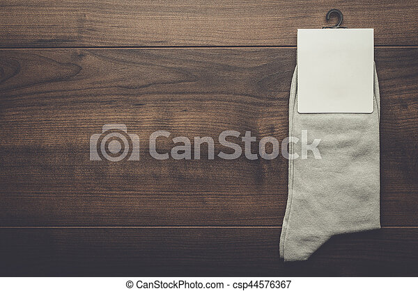 pair of gray socks with blank packing - csp44576367