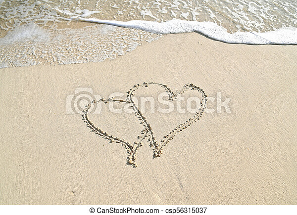 pair of hearts in beach sand - csp56315037