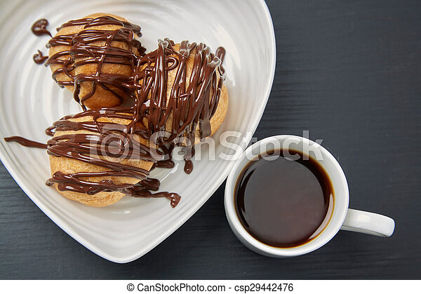 Pair of Tasty Pastries and Tea on Gray Table - csp29442476