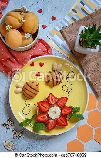 Pancake with fruits for kids breakfast - csp70746059