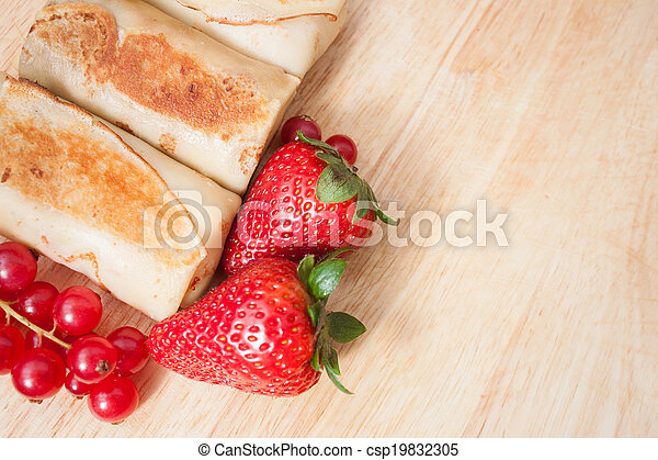 Pancakes with berries background - csp19832305