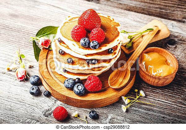 Pancakes with fresh summer berries - csp29088812