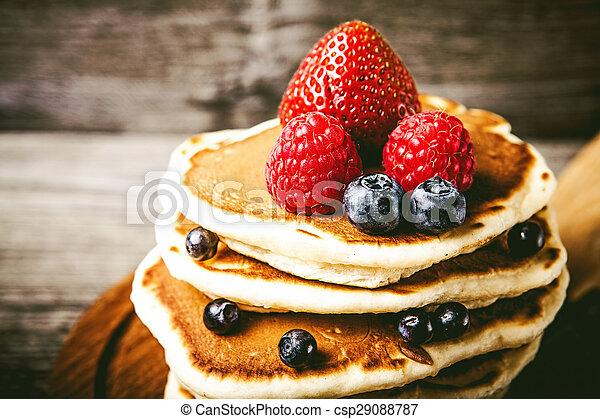 Pancakes with fresh summer berries - csp29088787