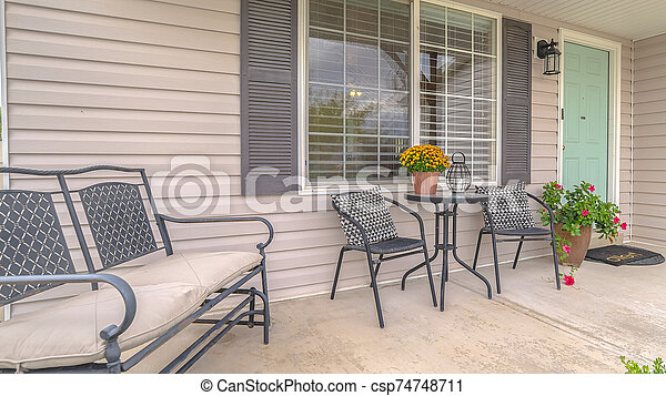 Panorama Frame Front Porch Of Modern Home With Outdoor Furniture The Front Porch Of A Modern Suburban Home With Outdoor