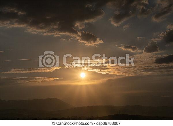 panorama of a fiery sunrise - sunset - csp86783087