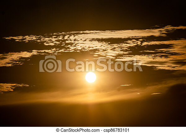 panorama of a fiery sunrise - sunset - csp86783101