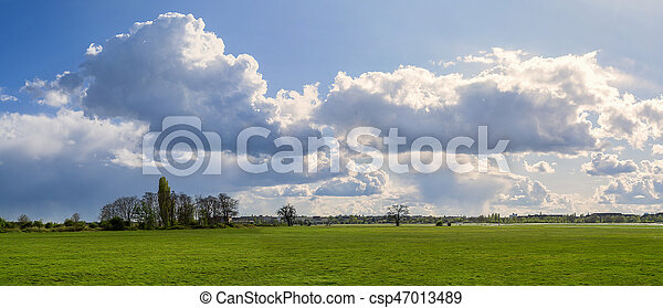 panorama of a landscape with beautiful cloudscape - csp47013489