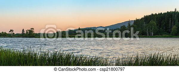 Panorama of a small lake at dusk - csp21800797
