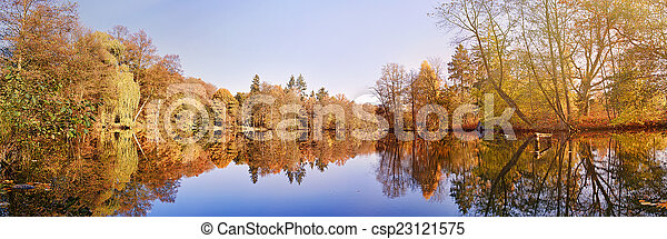 panorama of autumn trees at a glassy lake - csp23121575