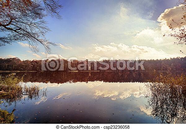 panorama of autumn trees at a glassy lake - csp23236058