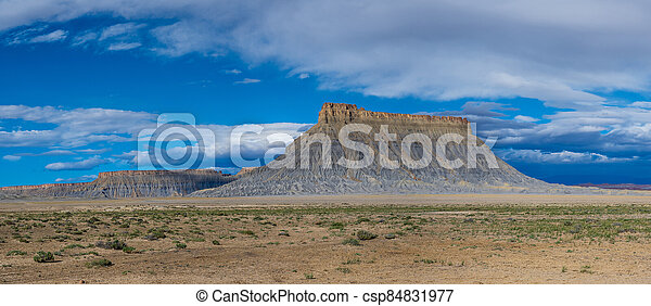 Panorama of factory butte on a cloudy morning - csp84831977