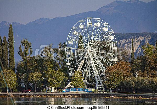 Panorama of Garda Lake in Bardolino with Ferris wheel 2 - csp85158541