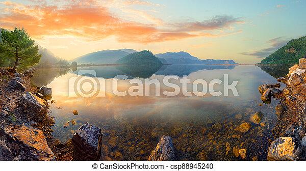 Panorama of mountain lake at sunset - csp88945240