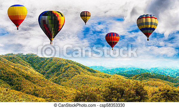 Panorama of mountain with hot air balloons on morning at Thailand. - csp58353330
