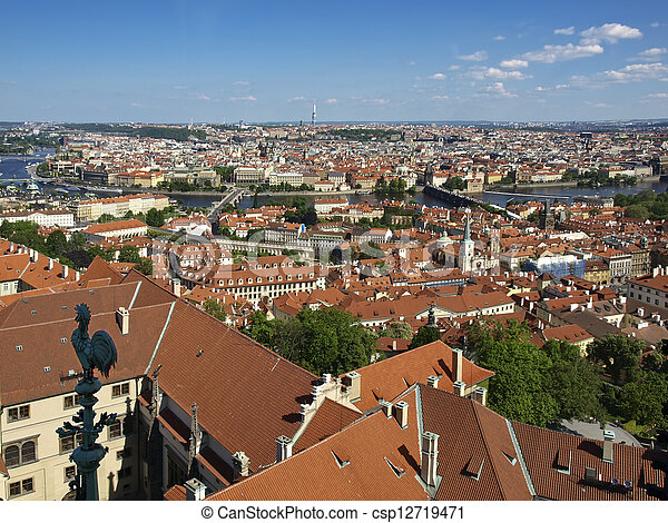 Panorama of Prague from the bell tower of the Cathedral of St. Vitus in the direction of Old Town. Tiled roofs, the river and bridges.  - csp12719471