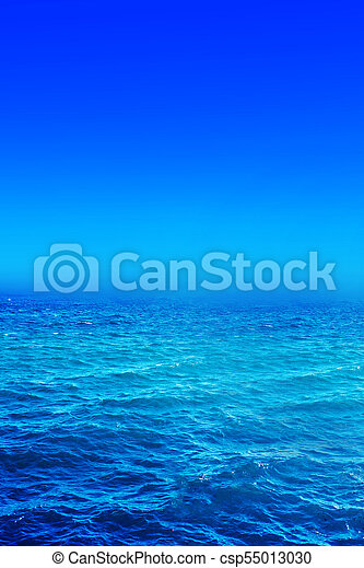 Panorama of sea waves. Landscape view of aqua blue sea and blue sky and with sunny reflections - csp55013030