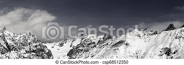 Panorama of snowy mountains at sunny winter day - csp68512350
