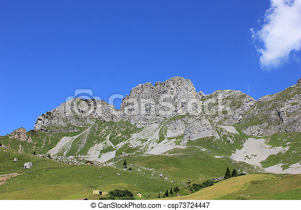 Panorama of swiss mountains on a sunny day in summer - csp73724447