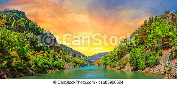 Panorama of the lake in the mountains at sunset - csp85900524