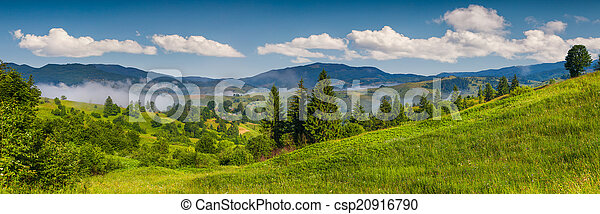 Panorama of the mountain village in a foggy summer morning - csp20916790