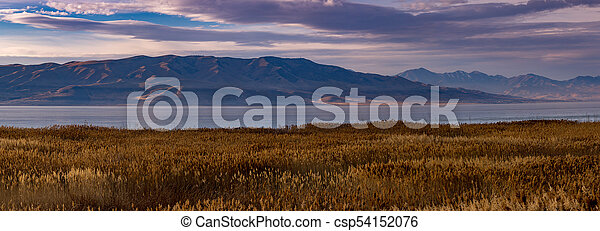 Panorama of the mountains and lake at sunrise - csp54152076