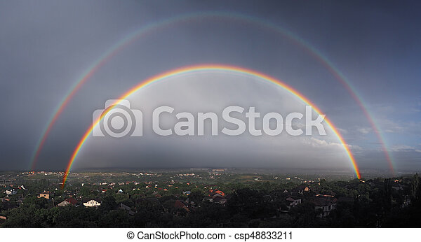 Panorama of the two large raibows over the the city after the rain view from mountain - csp48833211