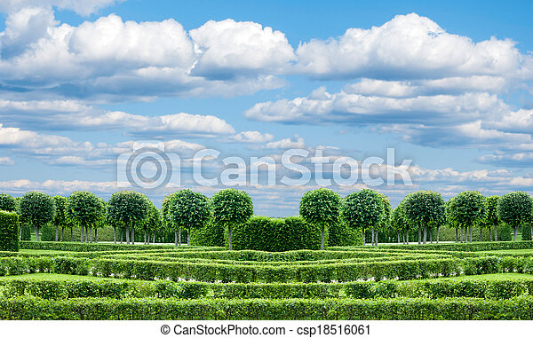 panorama Park with exactly topiary trees and lawn - csp18516061