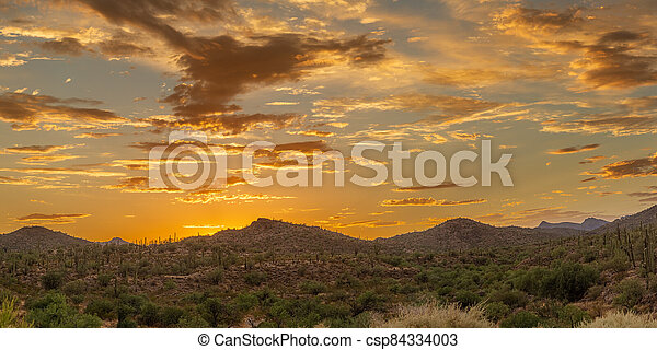 Panoramic sunset over a mountain landscape in the Sonoran Desert - csp84334003