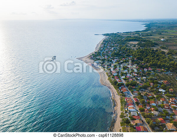 Panoramic top view of a coastal line. Aerial drone bird's eye view photo. - csp61128898
