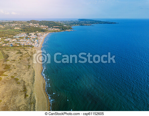 Panoramic top view of a coastal line. Aerial drone bird's eye view photo. - csp61152605