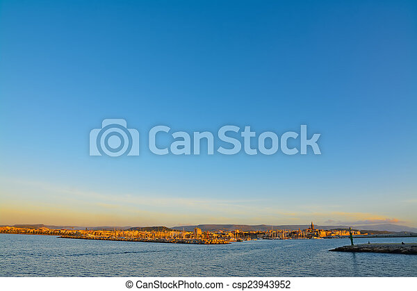 panoramic view of Alghero under a blue sky - csp23943952