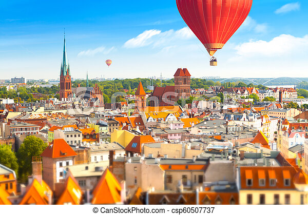 Panoramic view of historical buildings and roofs in Polish medieval town Torun - csp60507737