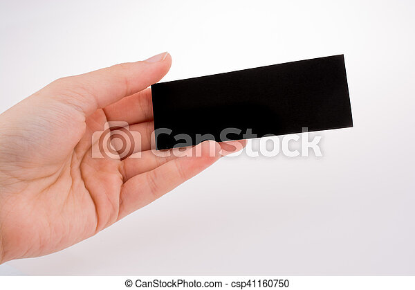 Un trozo de papel negro en la mano - csp41160750