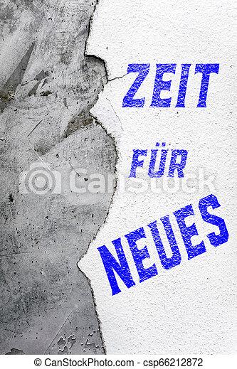 Un papel de pared rojizo con texto alemán que significa tiempo para algo nuevo - csp66212872