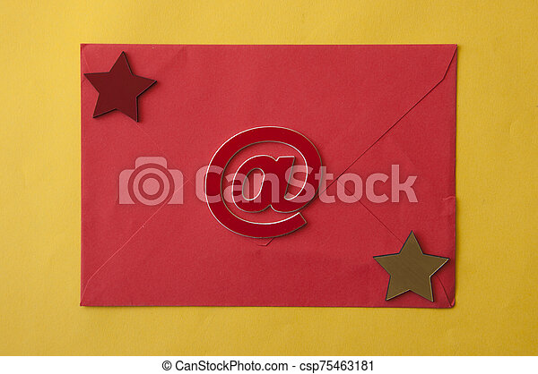 paper envelope on yellow paper background - csp75463181