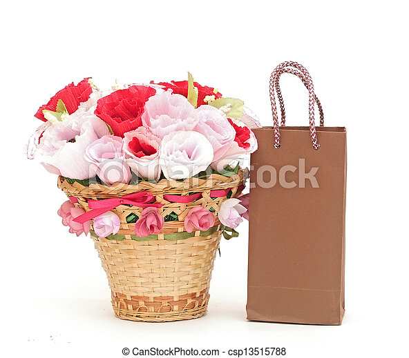 Paper flower in a basket with shopping bag - csp13515788