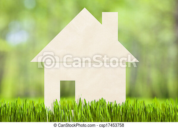 Paper house on green grass concept - csp17453758