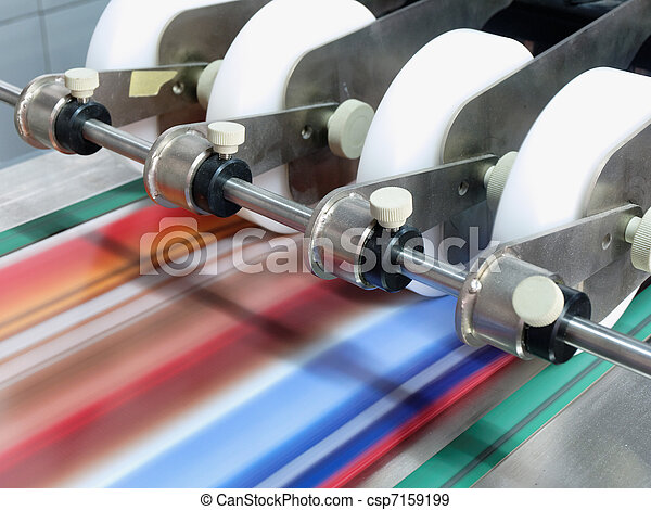 paper in a postpress folder station moving fast, situated in a printer work shop          - csp7159199