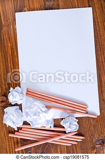 paper on wooden background - csp19081575