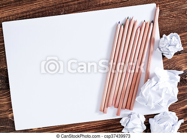 paper on wooden background - csp37439973