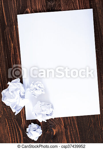 paper on wooden background - csp37439952